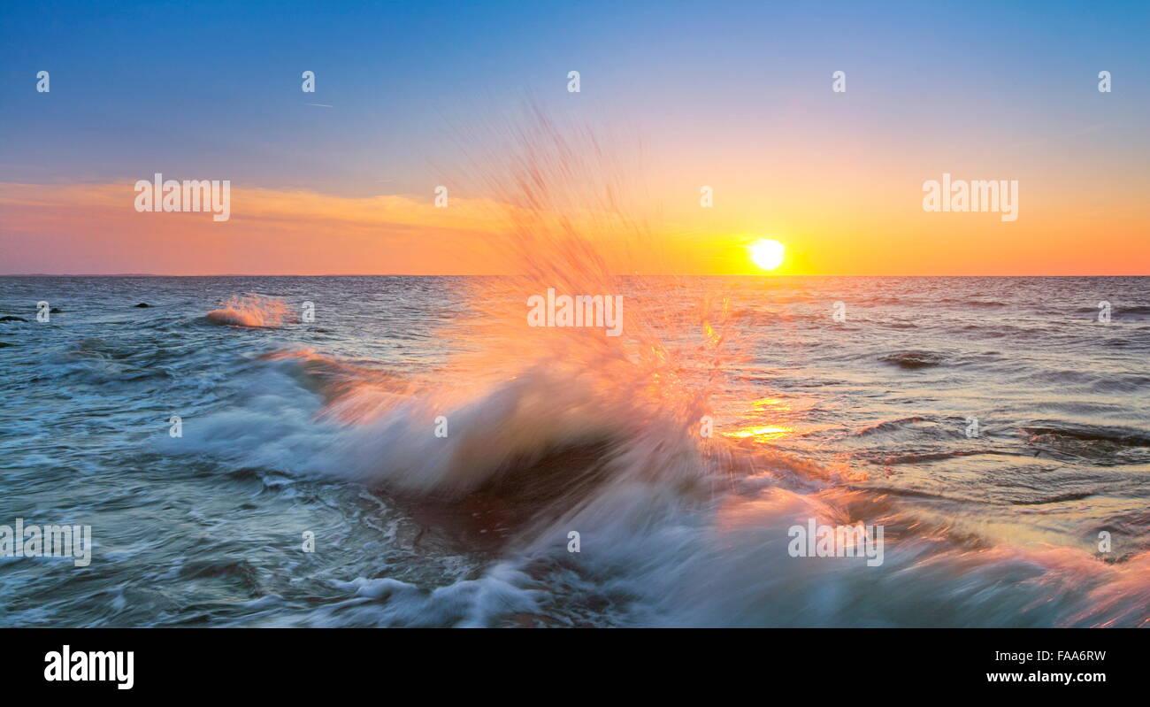Sea waves at sunset time, Baltic Sea, Pomerania, Poland - Stock Image
