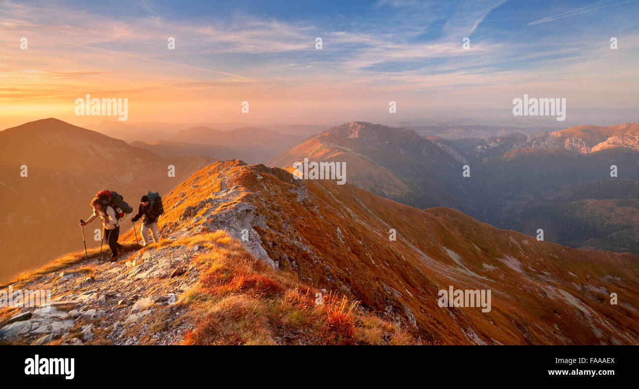 Tourists on the trail, autumn colors in Tatra Mountains, Poland - Stock Image