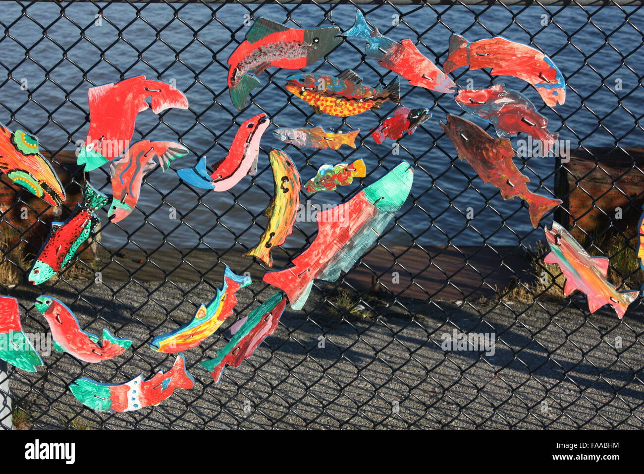 Fish decoration on a fence by the Fraser River in New Westminster, British Columbia, Canada - Stock Image