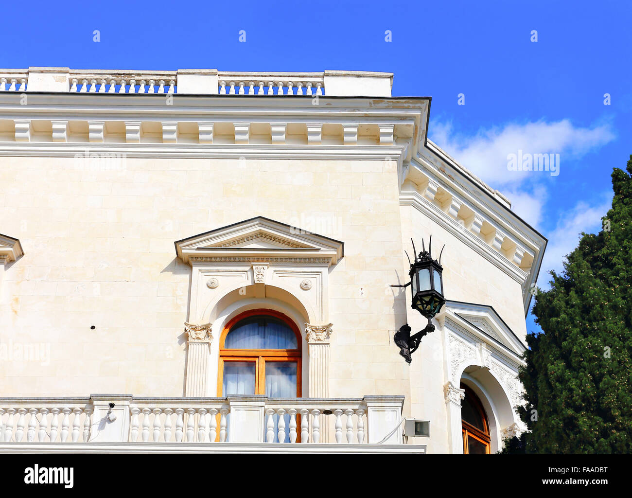Wall of white classical building with marble balcony - Stock Image