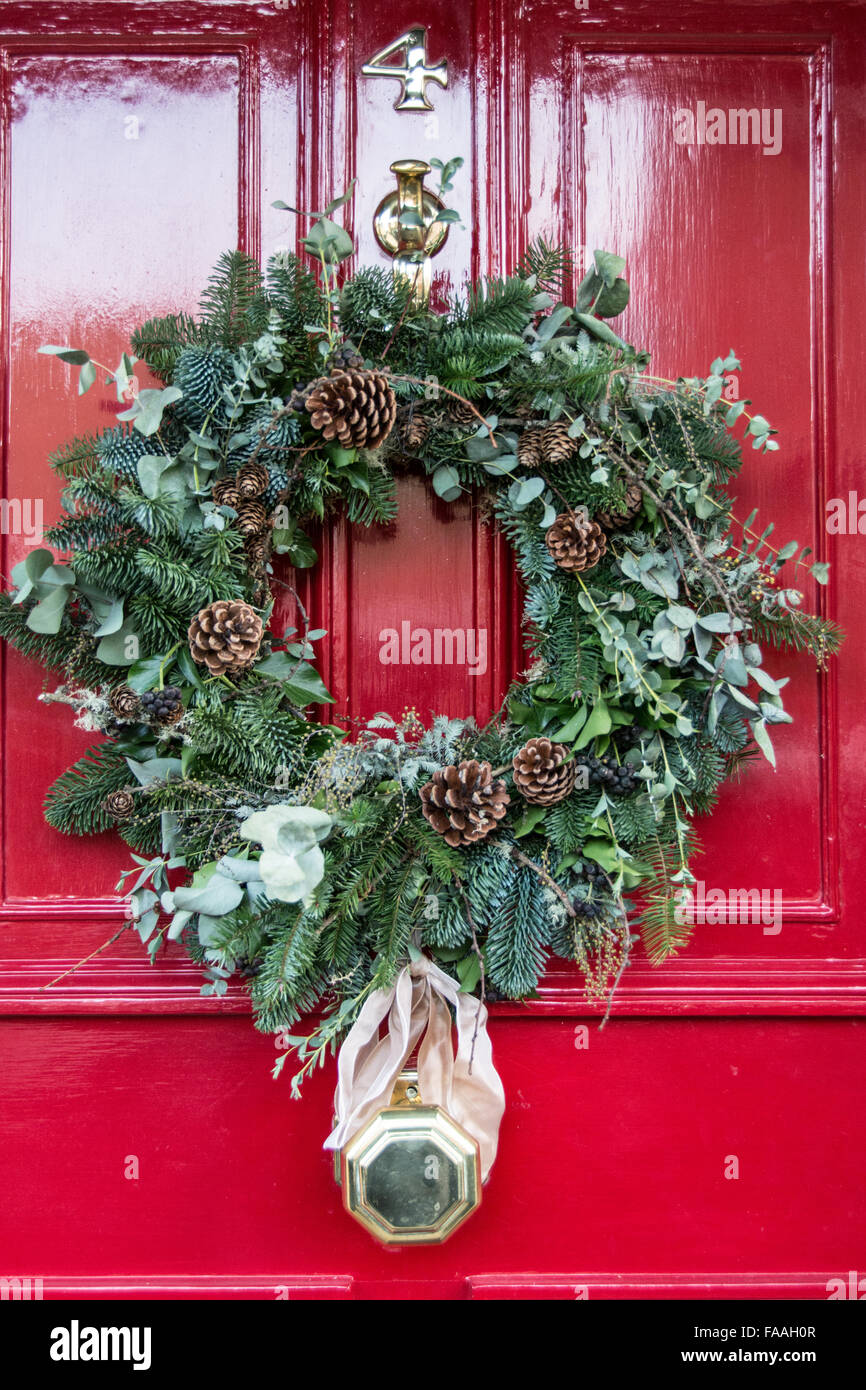 A Colourful Festive Christmas Wreath On An English Front Door Stock