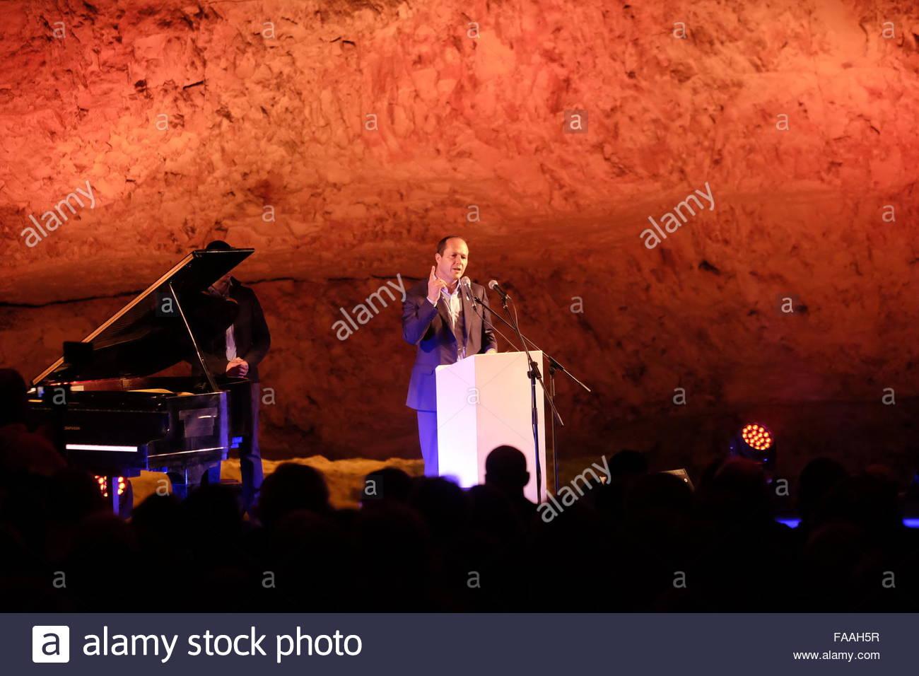 Nir Barkat mayor of Jerusalem addressing to the audience before a musical performance  inside Zedekiah's Cave - Stock Image
