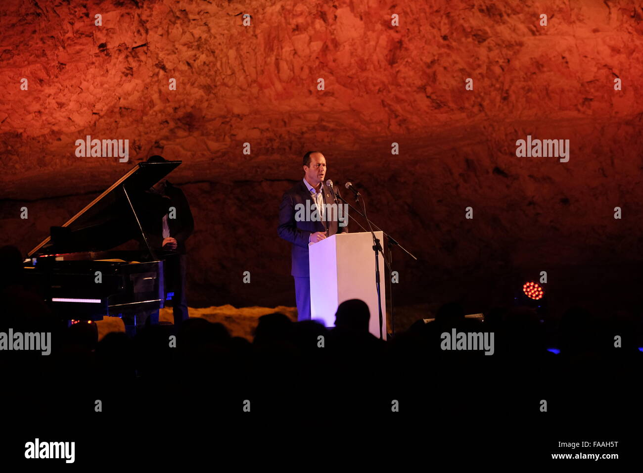 Nir Barkat mayor of Jerusalem addressing to the audience before a musical performance  inside Zedekiah's Cave - Stock Image