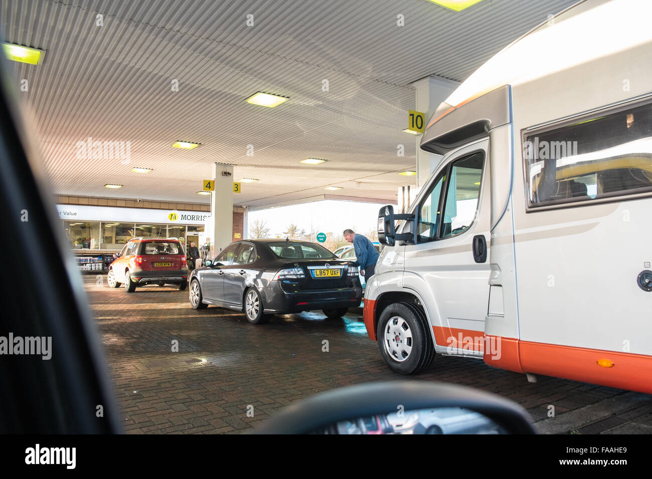 Carmarthen, Wales, UK. 11th December, 2015. car,cars,Vehicles,queue to fill up at Morrisons,petrol station,after - Stock Image