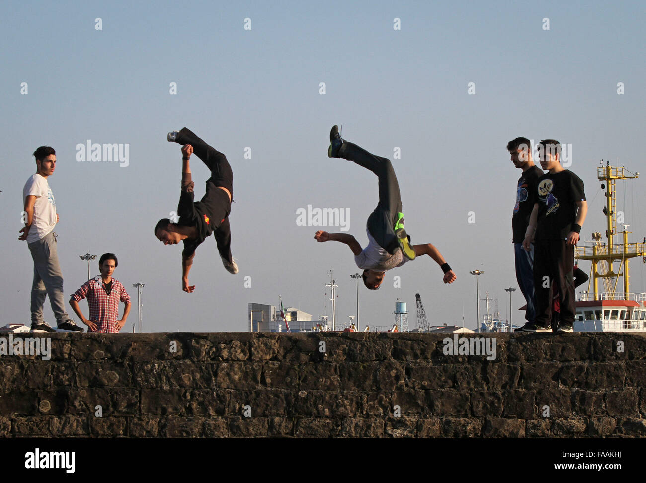 Anzali Port, Iran. 24th Dec, 2015. Iranian teens practice parkour in Anzali Port in Gilan province, northern Iran, Stock Photo