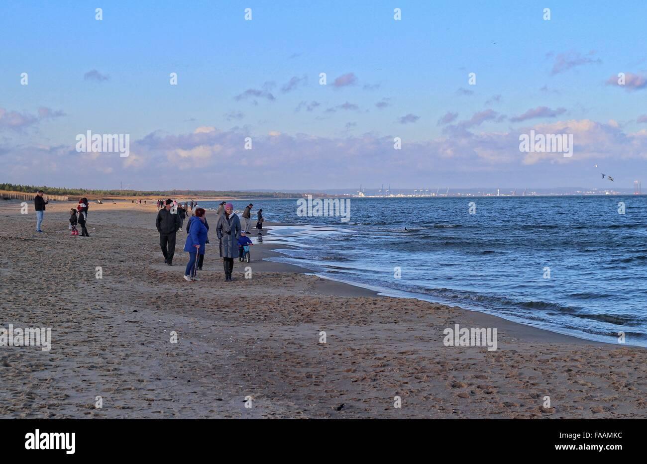 Gdansk, Poland 25th, Dec. 2015 People enjoy unusually warm December weather walking along the Baltic sea coast on - Stock Image