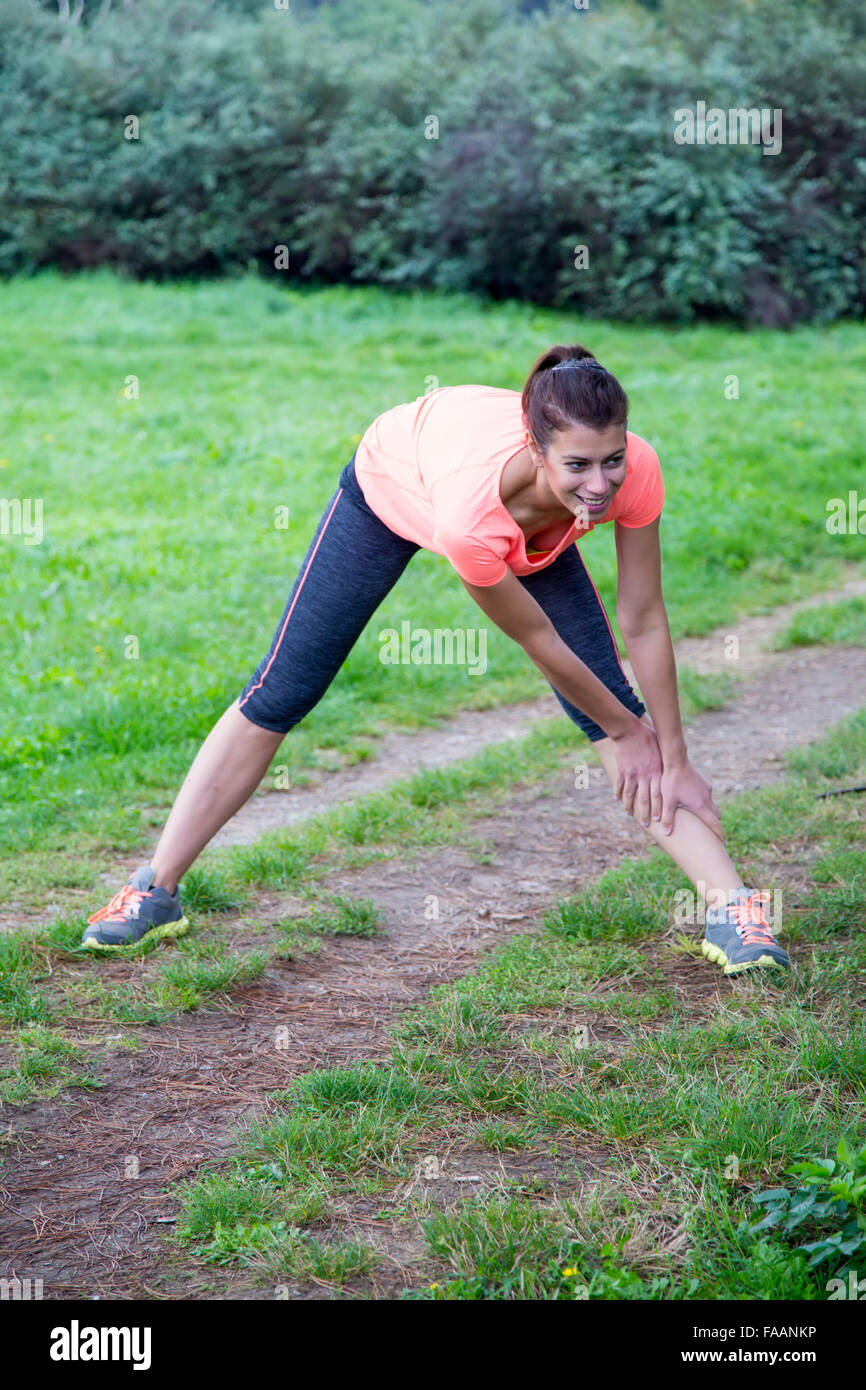 Young woman taking exercie in the park - Stock Image