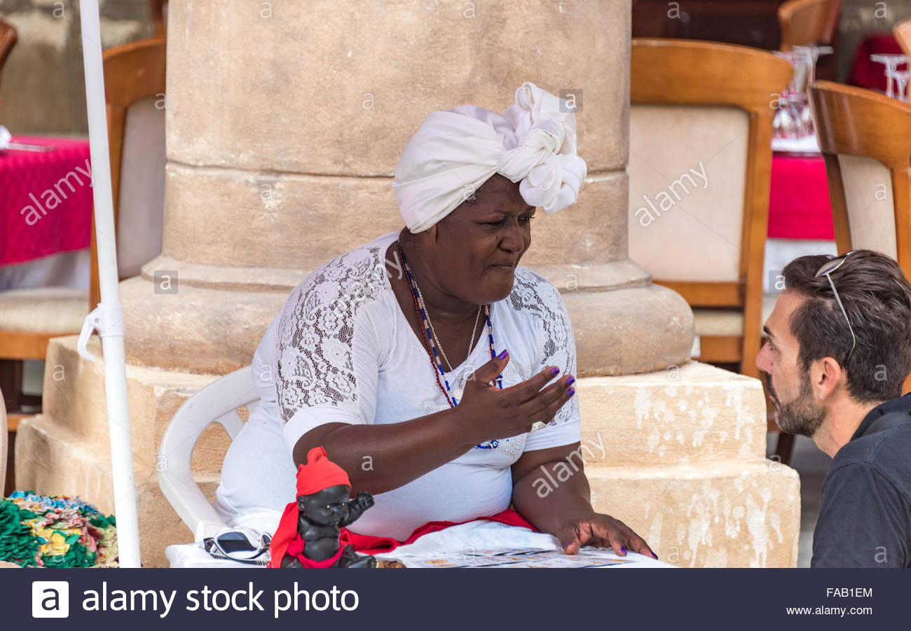 Afro Caribbean Fortune jTeller in Old Havana,Cuba. The lady belongs to a variation of African religions that are - Stock Image