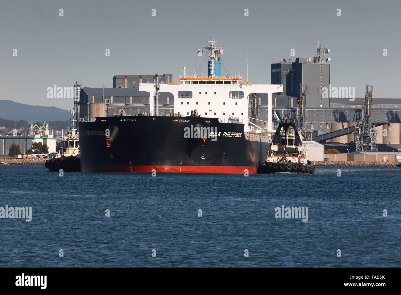 The bulkcarrier - Bulk Philippines departing with a full load of export coal from the Hunter Valley coal mines Newcastle - Stock Image