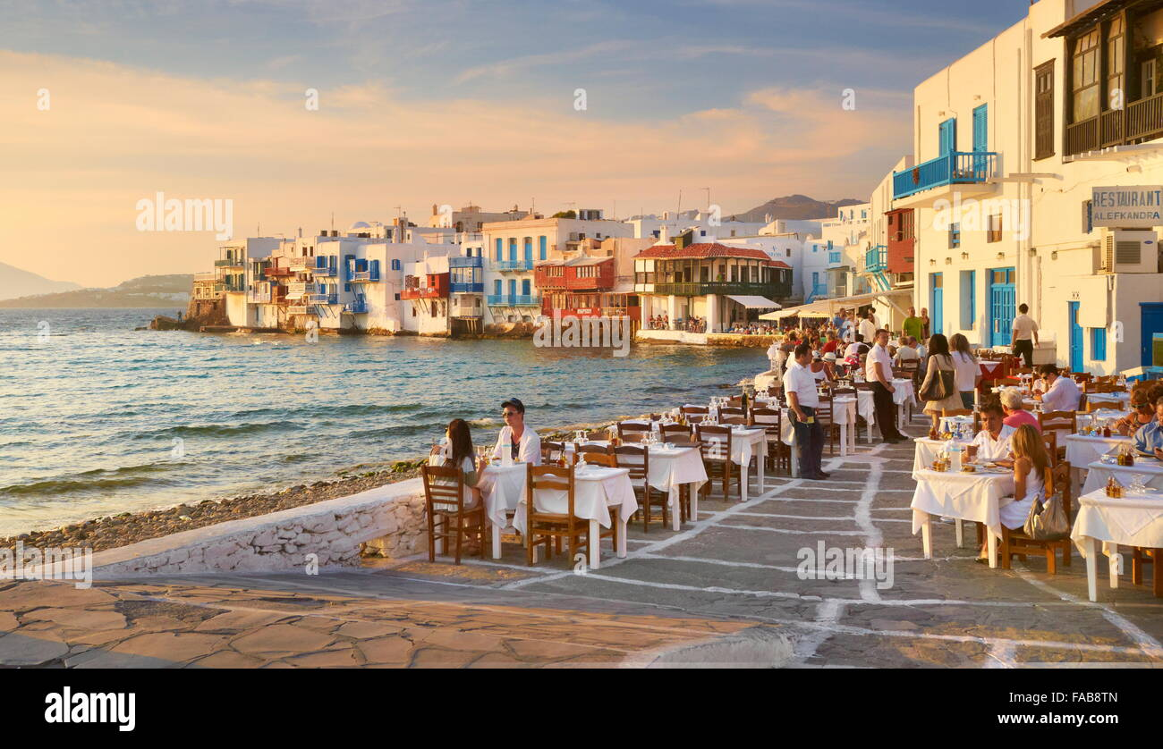 Outdoor restaurant, Mykonos Island Old Town, Little Venice in the background, Greece - Stock Image
