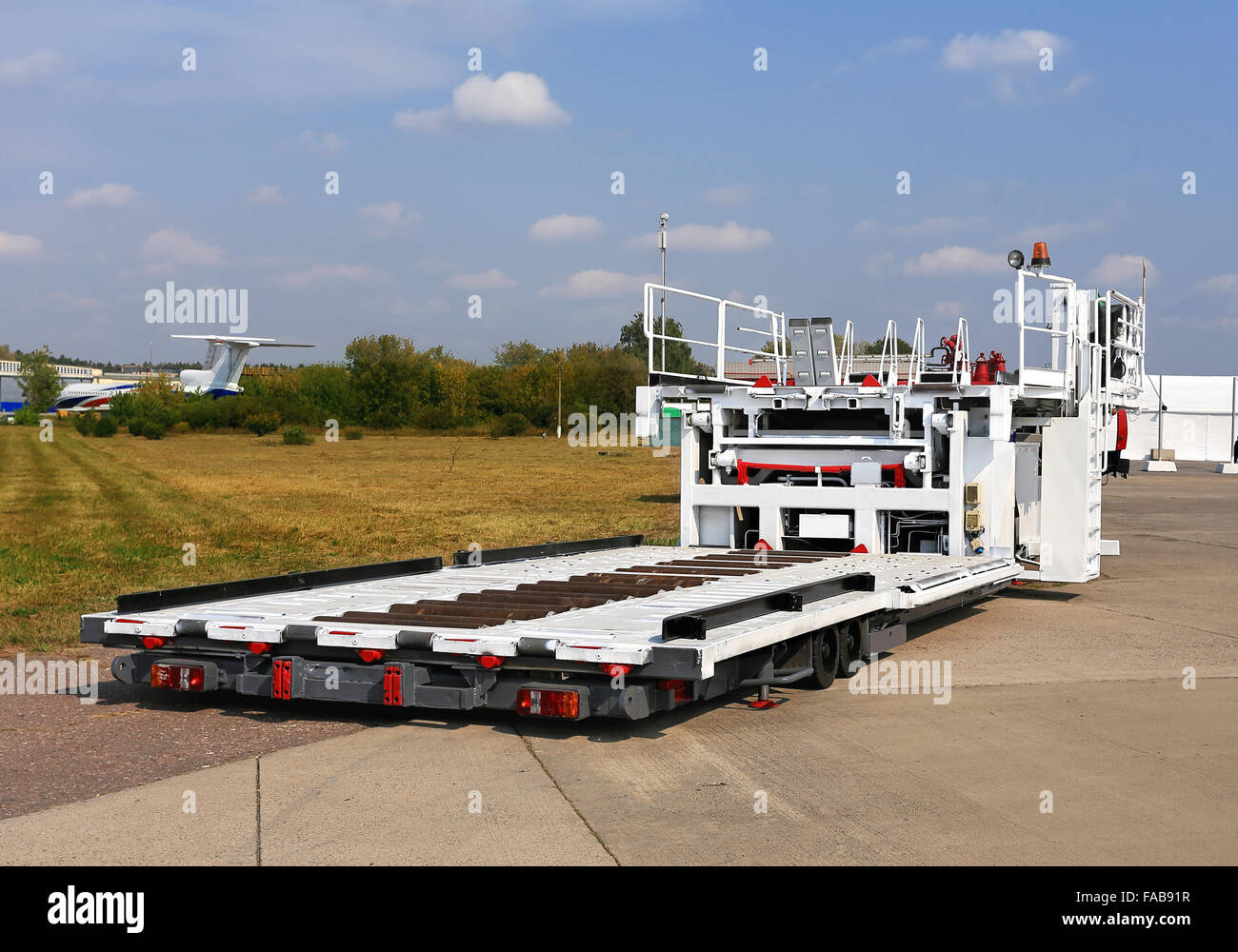 Airfield self-propelled platform for loading and unloading of aircraft - Stock Image