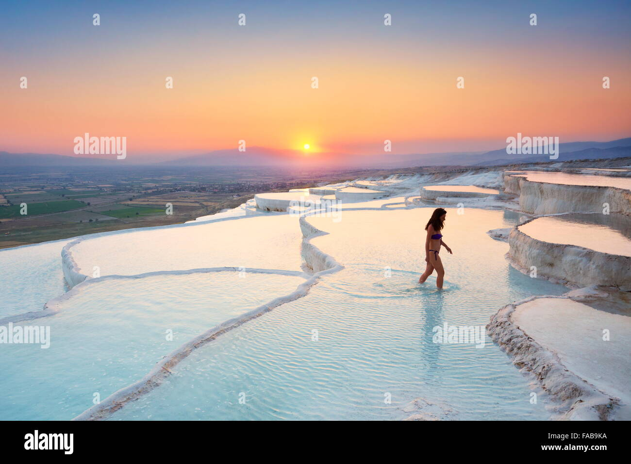 Pamukkale - limestone terraces at sunset, Pamukkale, Turkey Stock Photo