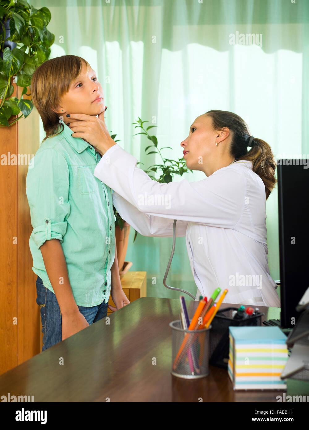 Doctor checking a boy