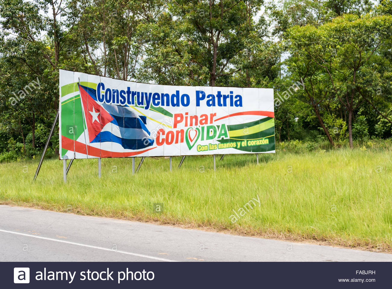 Government sign or propaganda at the entrance of Pinar del Rio, Cuba. The sign reads: Building our Nation, Pinar - Stock Image