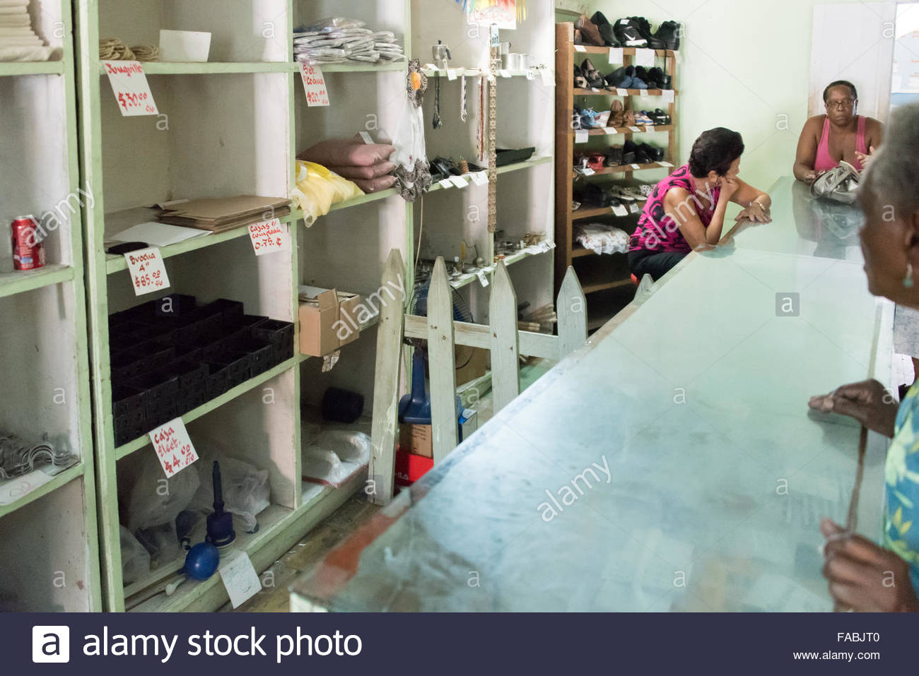 Division of work in a Cuban store in Pinar del Rio,Cuba A little fence divides the work on one employee from the Stock Photo