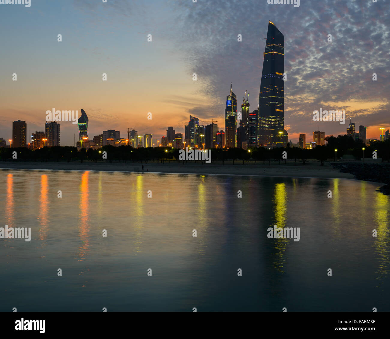 Kuwait City skyline at sunset, featuring Al-Hamra - Stock Image