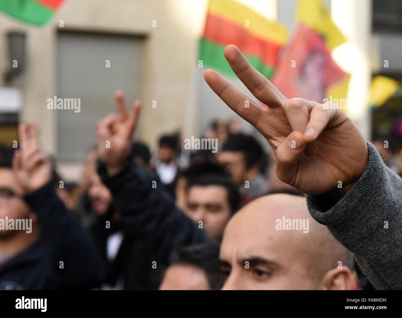 Duesseldorf, Germany. 26th December, 2015. Kurdish people with flags and banners have gathered to demonstrate in - Stock Image