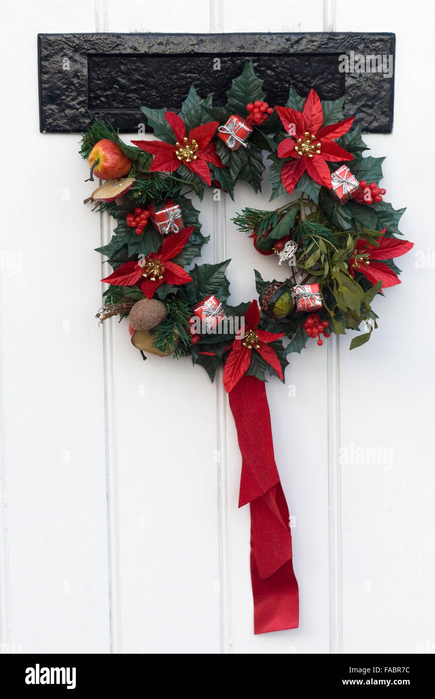 A Mistletoe Christmas Wreath On Front Door