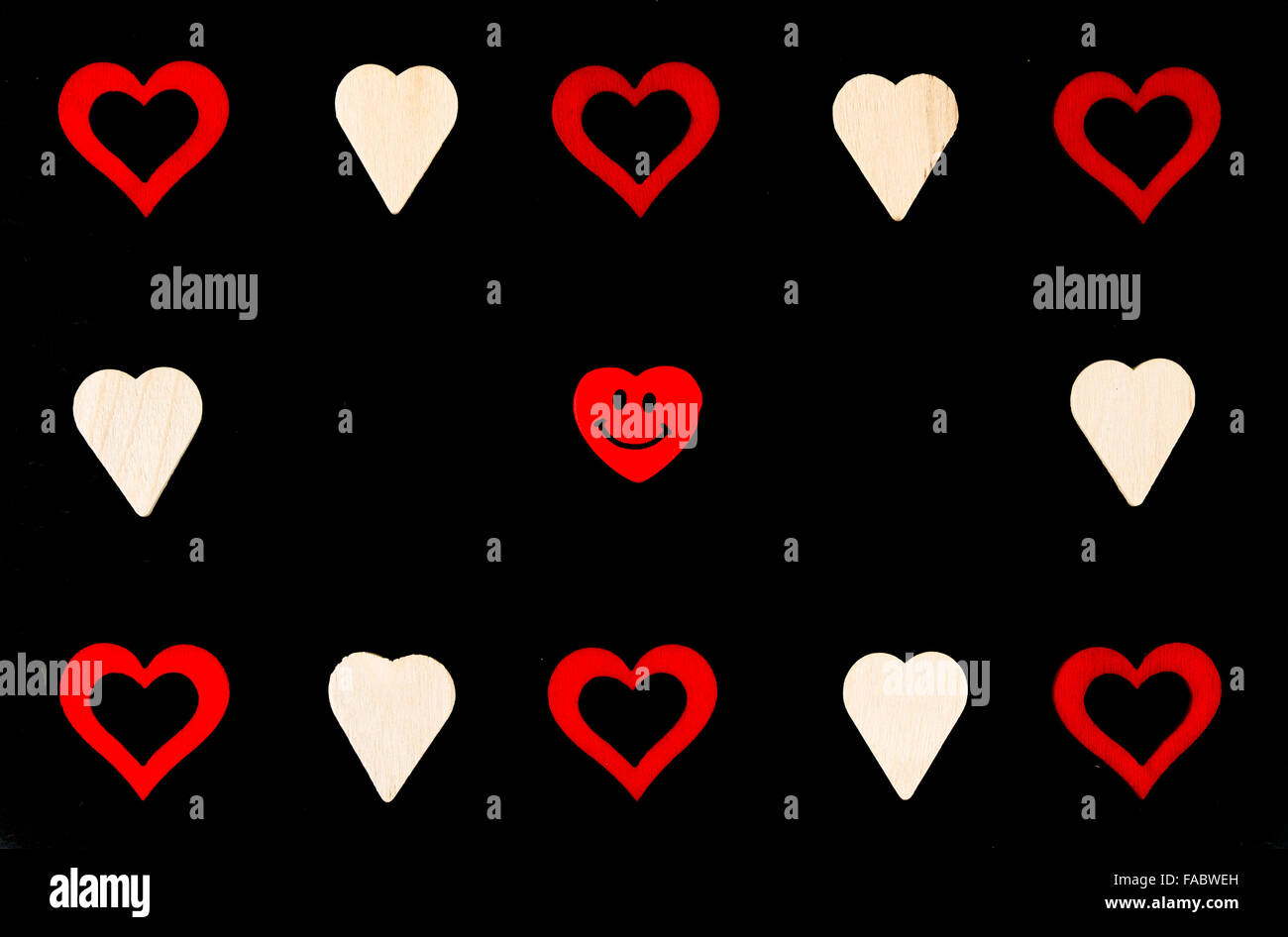 Heart Shapes Symbols And Smiling Emoticon Isolated On Black Stock