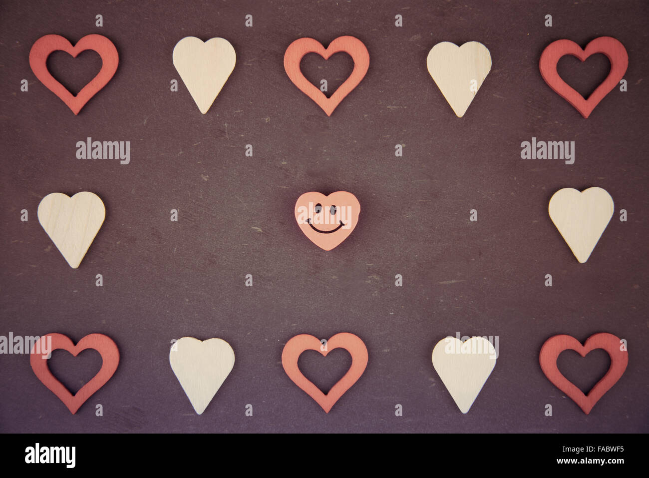 Heart Shapes Symbols And Smiling Emoticon Isolated On Black Vintage