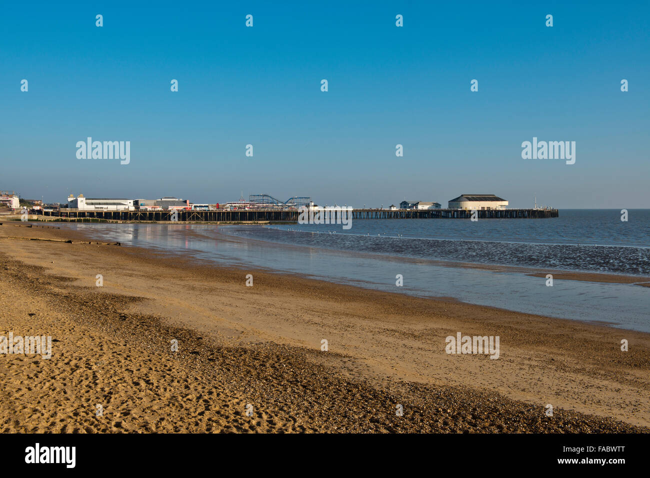 The Pier and empty beach at Clacton-on-Sea, Essex, UK. Image taken late December 2014 - Stock Image