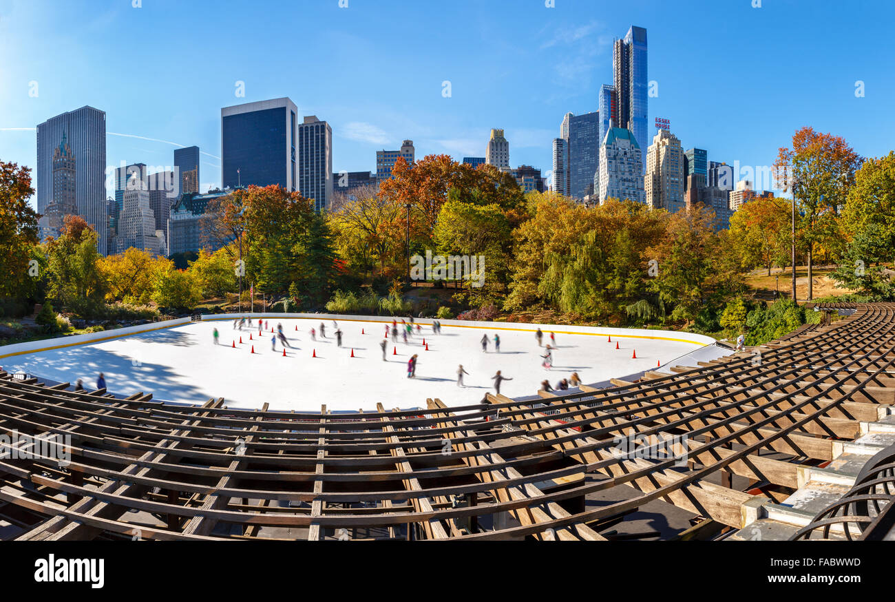 Wollman Skating Rink on a sunny morning in autumn, Central Park South and Midtown Manhattan skyscrapers. New York - Stock Image