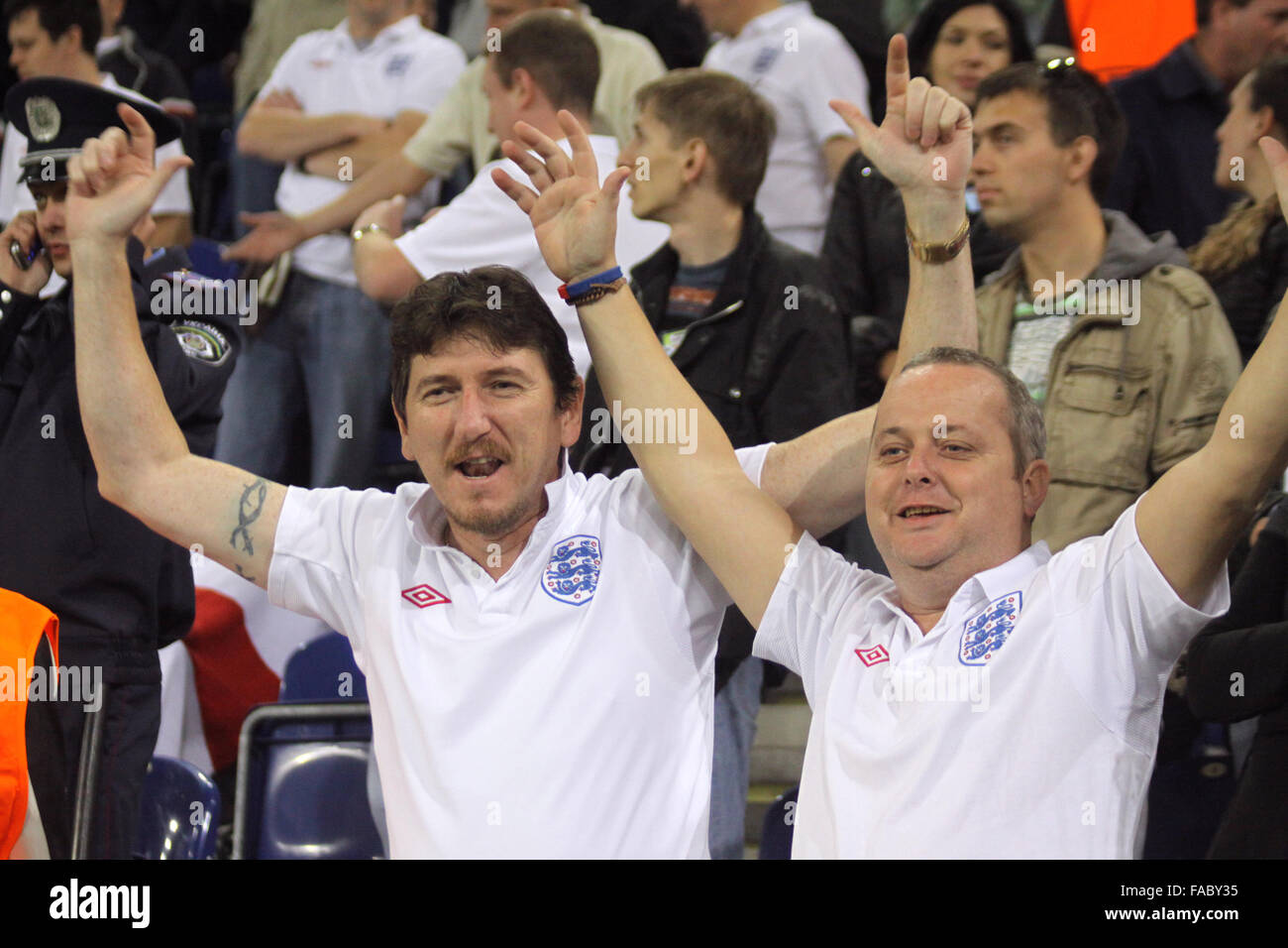 DNIPROPETROVSK, UKRAINE - OCTOBER 10, 2009: England fans react during World Cup 2010 qualifying football match against - Stock Image