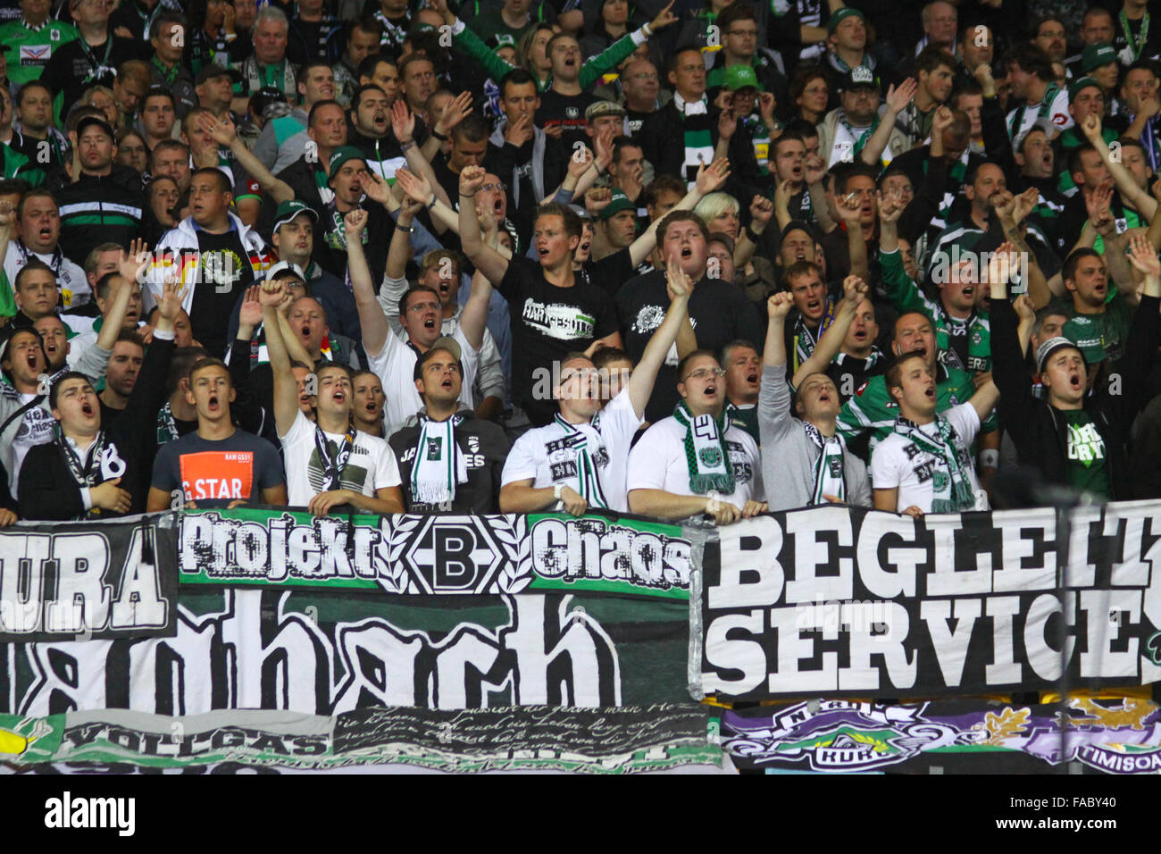KYIV, UKRAINE - AUGUST 29, 2012: Borussia Monchengladbach team supporters show their support during UEFA Champions - Stock Image