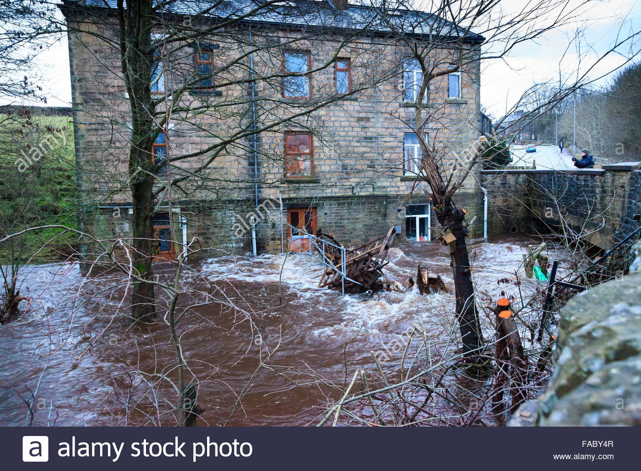Providence Lane,Haworth, West Yorkshire, UK. 26 December 2015. Houses next to swollen River Worth  after heavy rainfall. Stock Photo