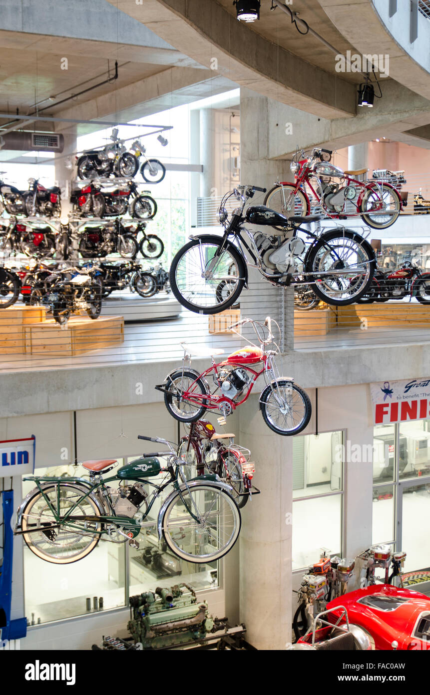 A display of motorcycles hangs from the ceiling at the Barber Vintage Motorsports Museum, Birmingham, Alabama, USA - Stock Image