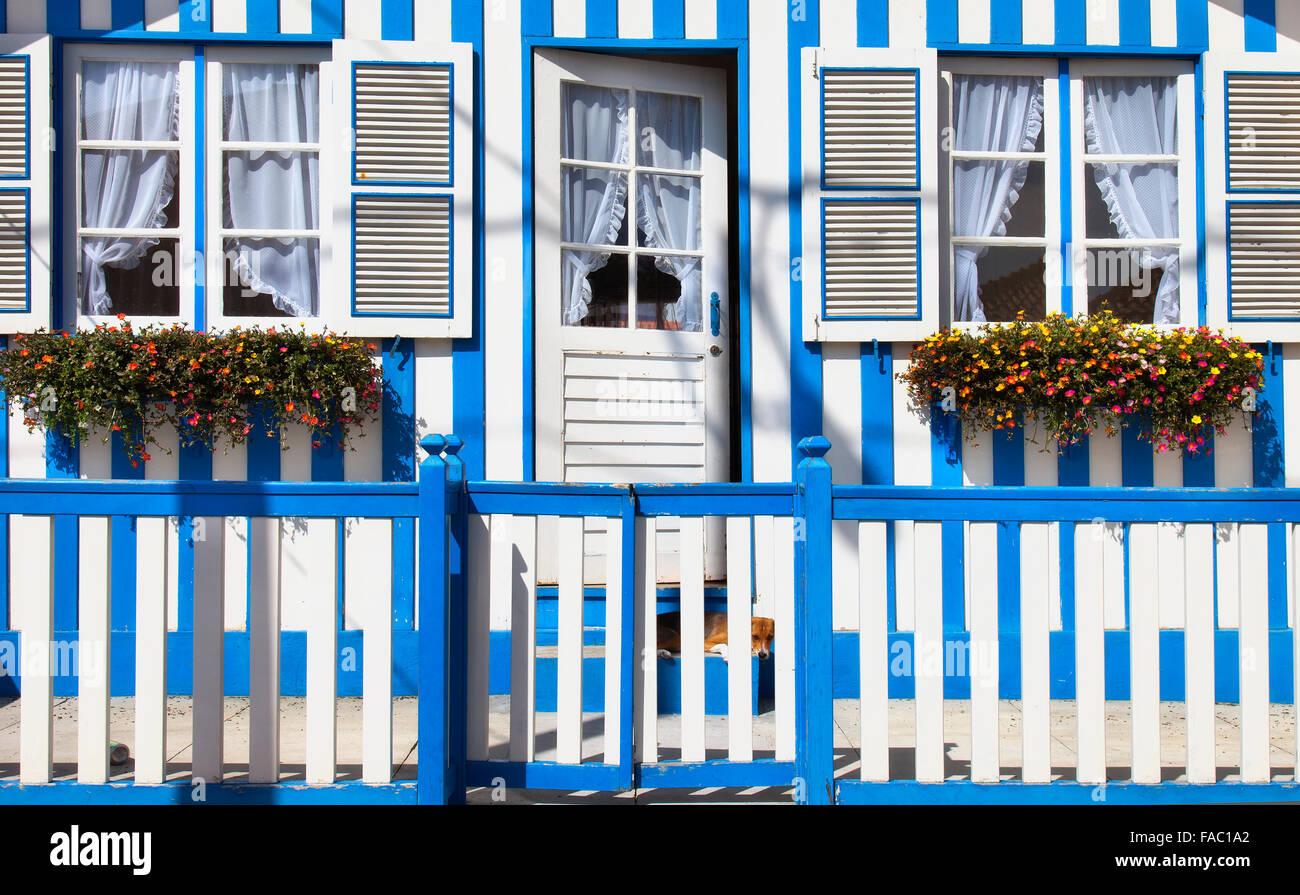 Colorful striped fishermen's houses in blue and white, Costa Nova, Aveiro, Portugal Stock Photo