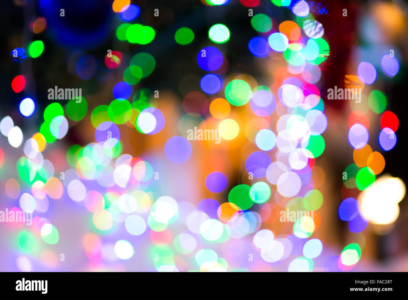 Garland blurred Christmas colorful lights background - Stock Image