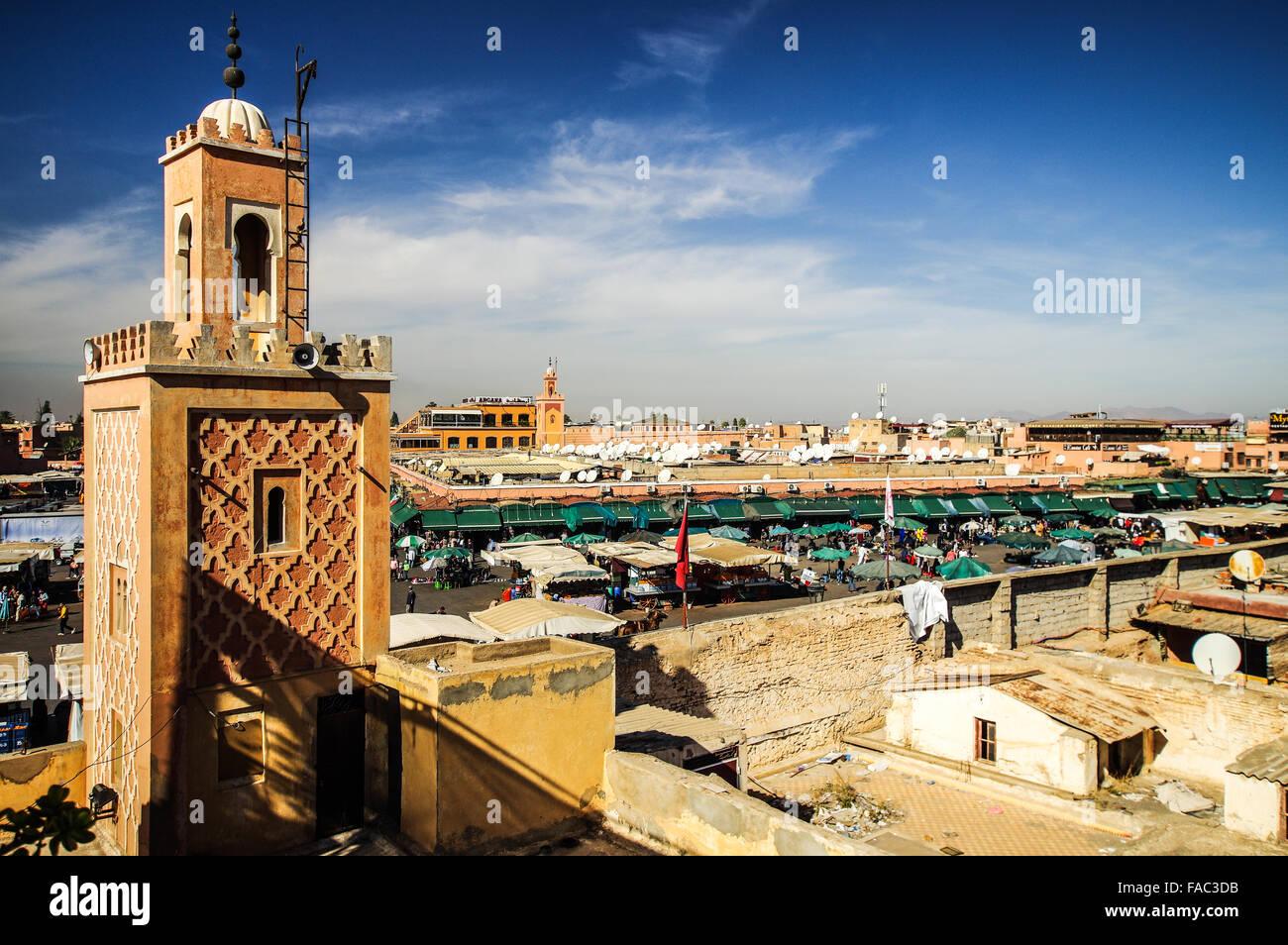 Minaret overlooking Jemaa el Fnaa square in Marrakech, Morocco - Stock Photo