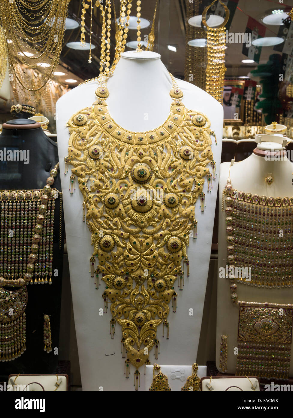 Window display of gold necklace and ornaments in Dubai gold souk, United Arab Emirates (UAE). - Stock Image