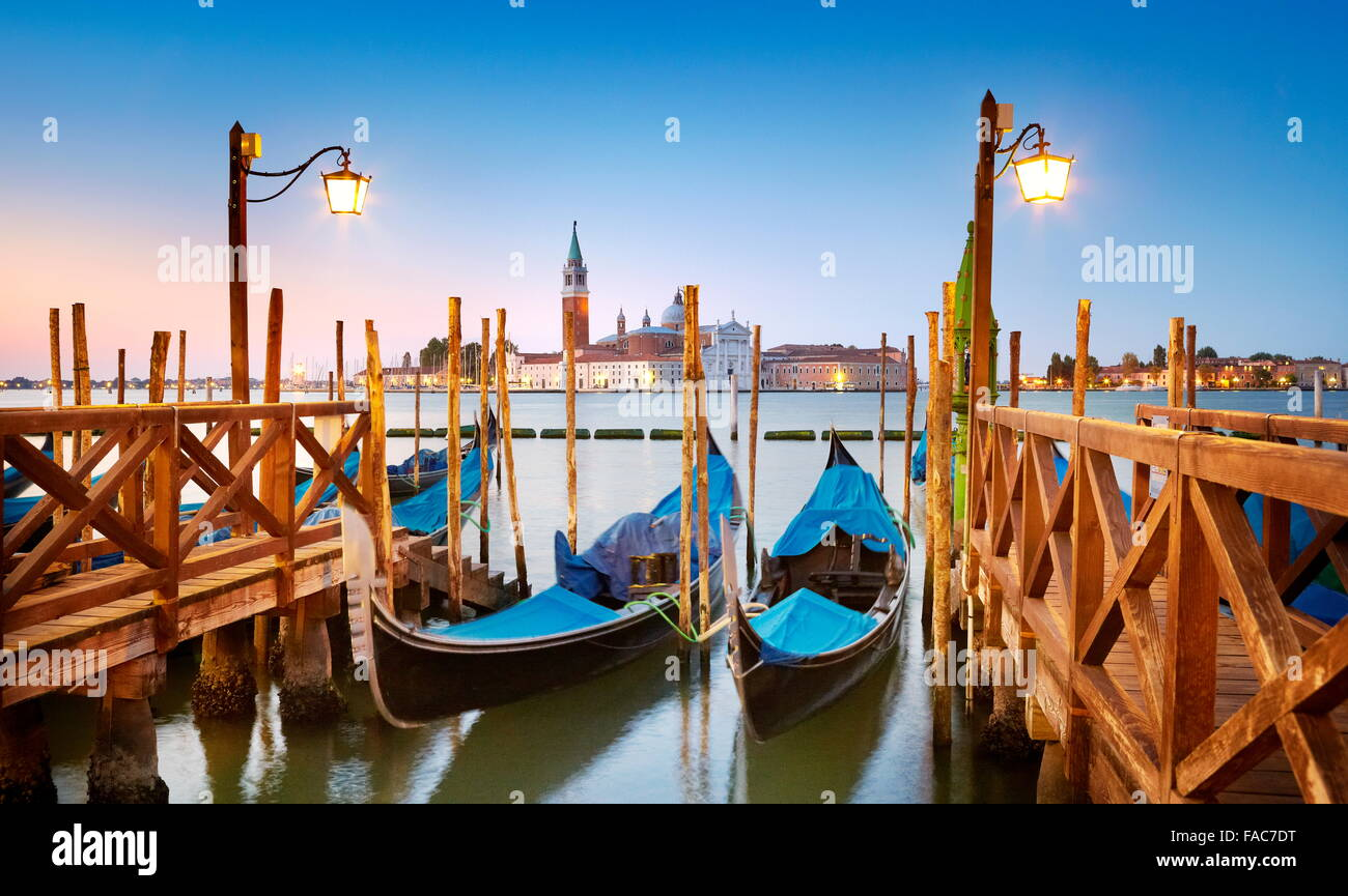 Venetian gondola moored on Grand Canal (Canal Grande) and San Giorgio Maggiore Church in background, Venice, Italy - Stock Image