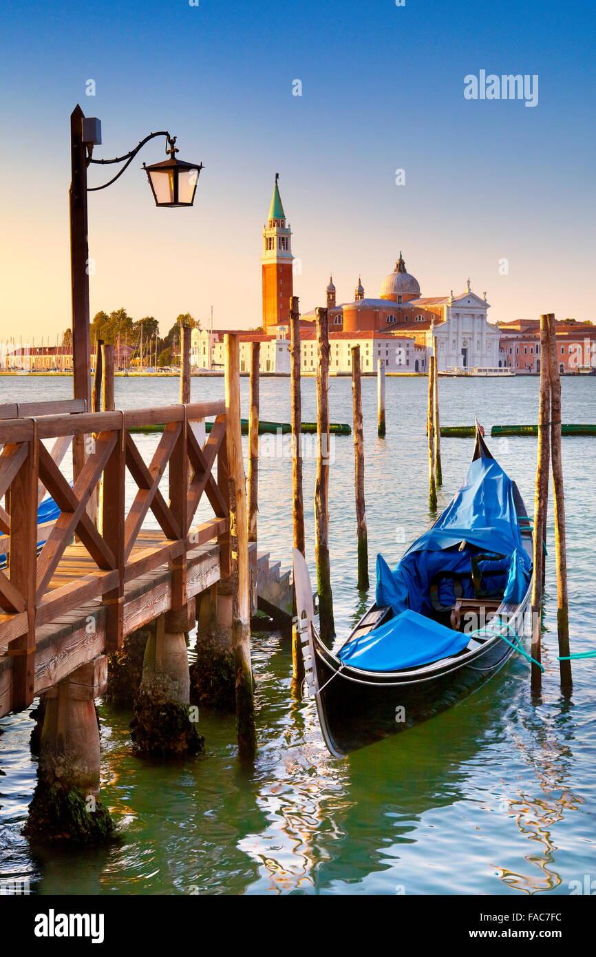 Venice Grand Canal - venetian gondola moored to molo San Marco, Venice, Italy - Stock Image
