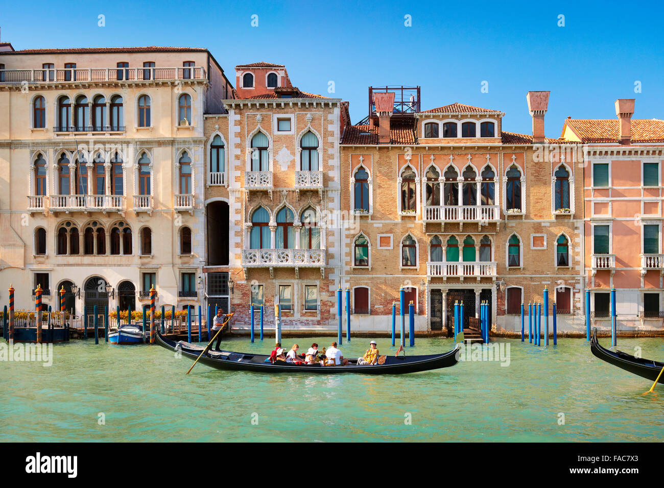 Venice, Italy - tourists in gondola on Grand Canal - Stock Image