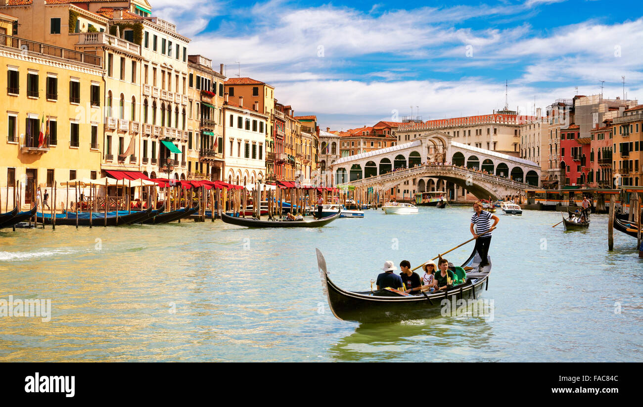 Gondola on the Grand Canal at Rialto Bridge in Venice, Italy, UNESCO Stock Photo