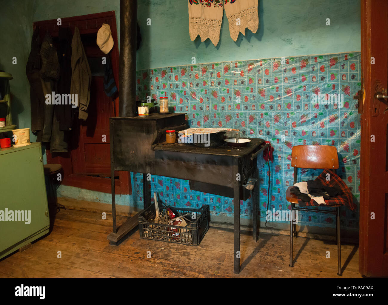 Traditional wood-burning stove in a house in the district of Maramures, Romania - Stock Image