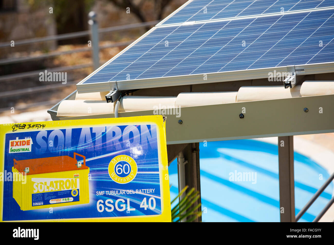 Solar panels on a roof in Sivota, Greece, with a swimming ...