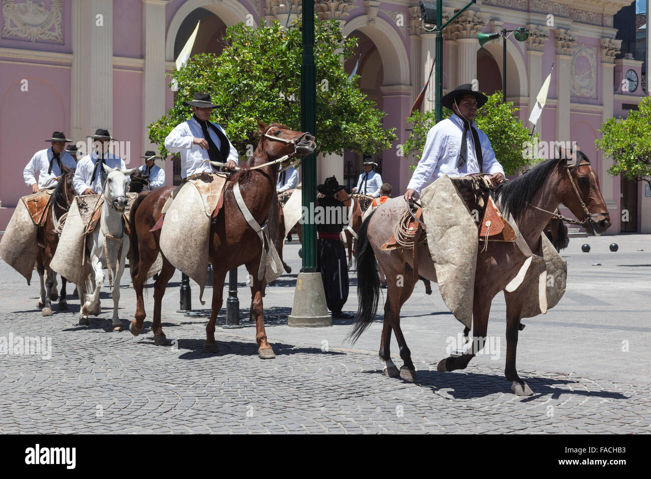 Gauchos on horseback in the town centre of Salta, Argentina - Stock Image