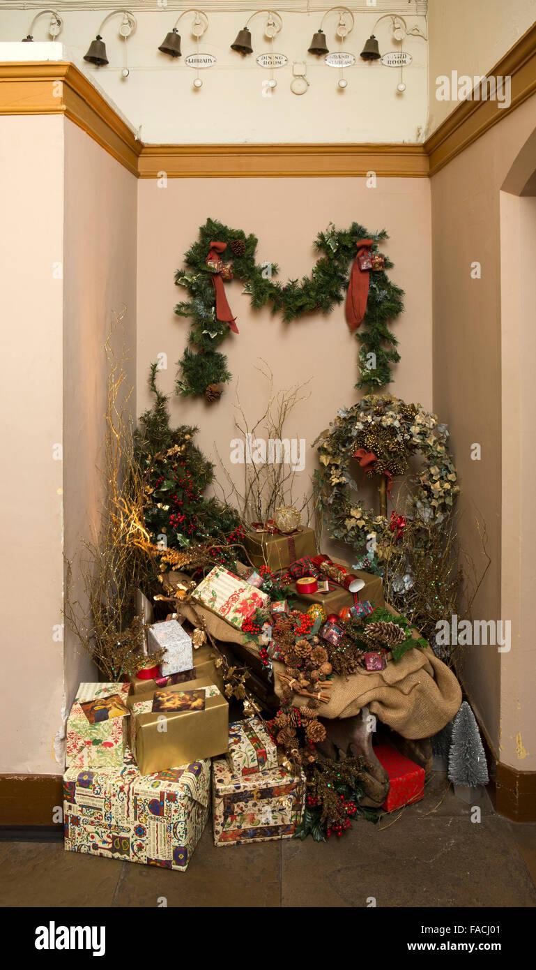 UK, England, Cheshire, Knutsford, Tatton Hall, Christmas presents below Servant's Bells - Stock Image