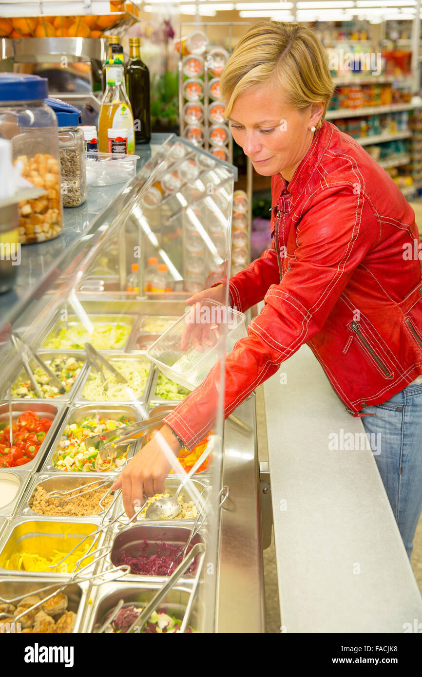Woman in a supermarket at the salad bar Stock Photo
