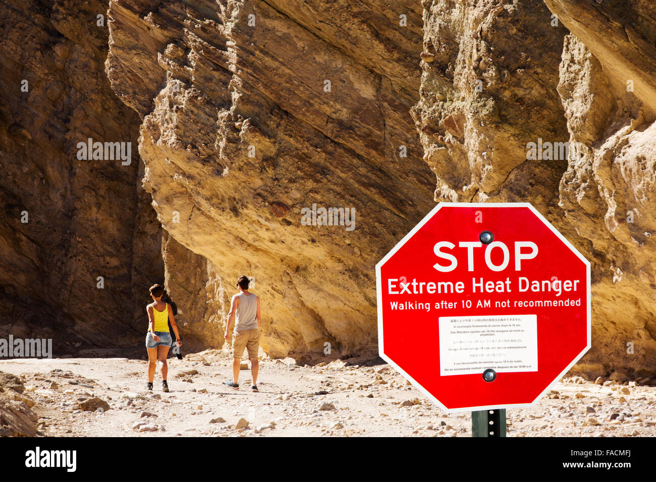 Tourists in Red Canyon, Death Valley which is the lowest, hottest, driest place in the USA, with an average annual - Stock Image