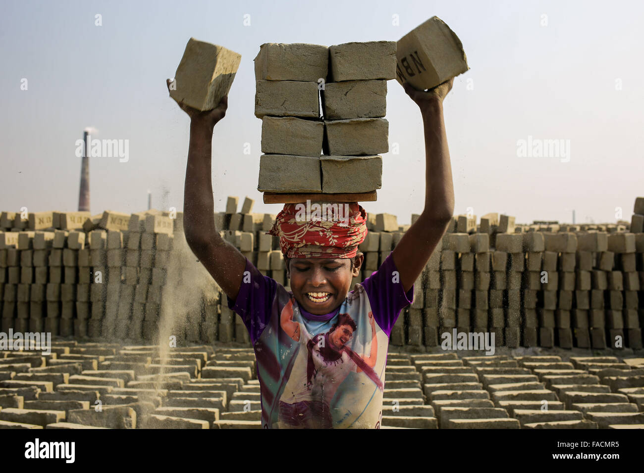 Dhaka, Bangladesh. 27th Dec, 2015. SAJIB is a 12 year old boy who is working in a brick yard. His parents also work - Stock Image