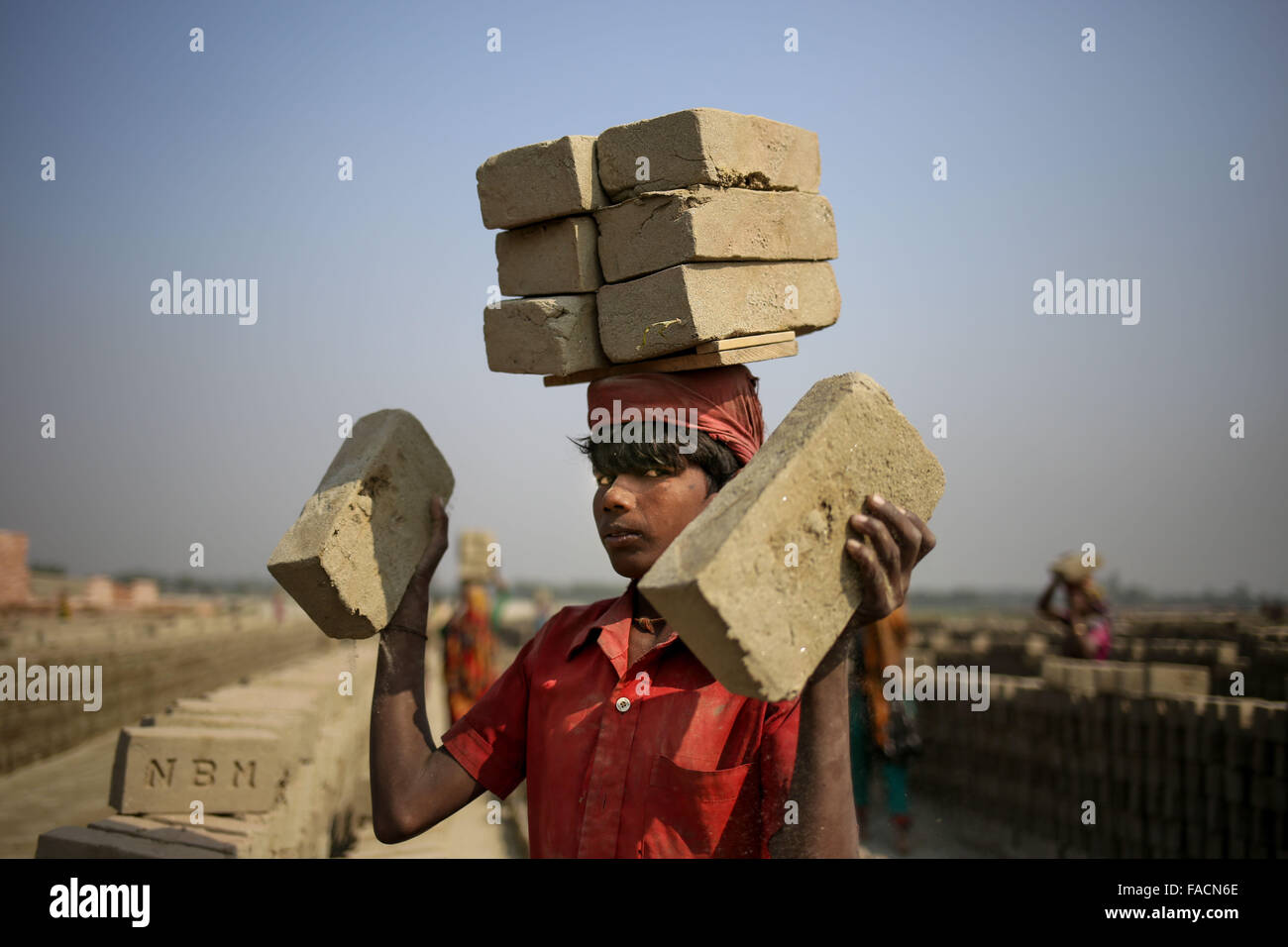 Dhaka, Bangladesh. 27th Dec, 2015. HOHHAIN is a 12 year old boy who works in brickyard where his parents also work.The - Stock Image