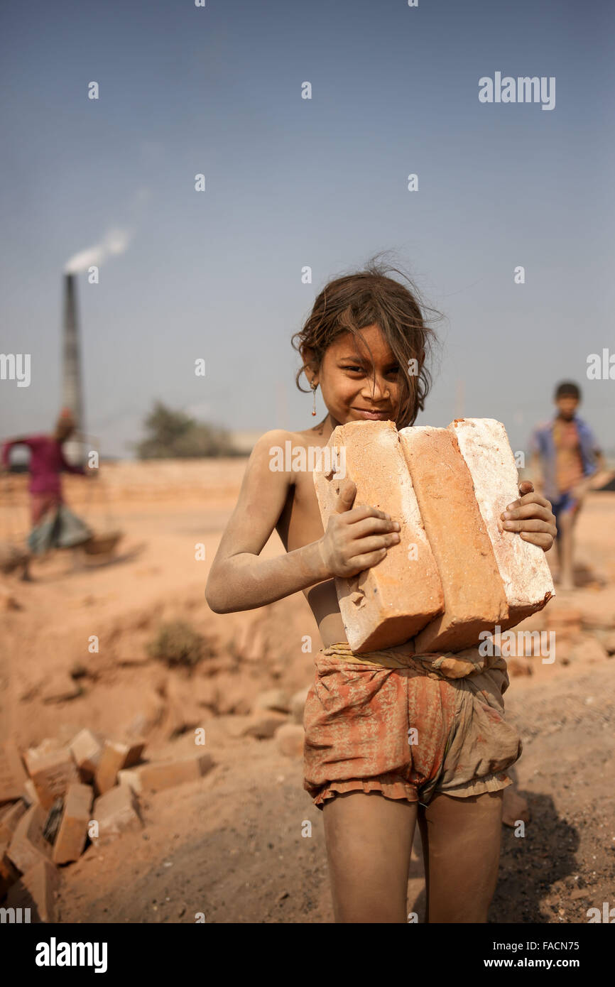 Dhaka, Bangladesh. 27th Dec, 2015. SHUMI is a 9 year old girl who works in brickyard where his parents also work. - Stock Image