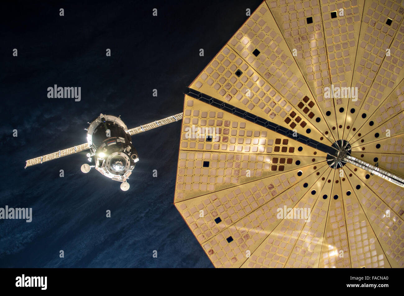 The Russian Soyuz TMA-19M spacecraft approaches for a manual docking to the Rassvet module at the International - Stock Image