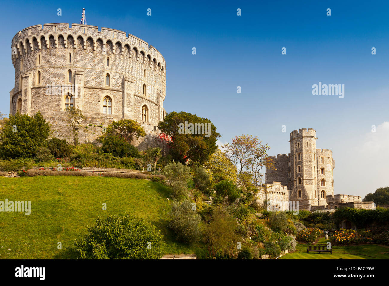 The garden below the Round (left) and King Edward III (right) Towers at Windsor Castle, Berkshire, England, UK - Stock Image
