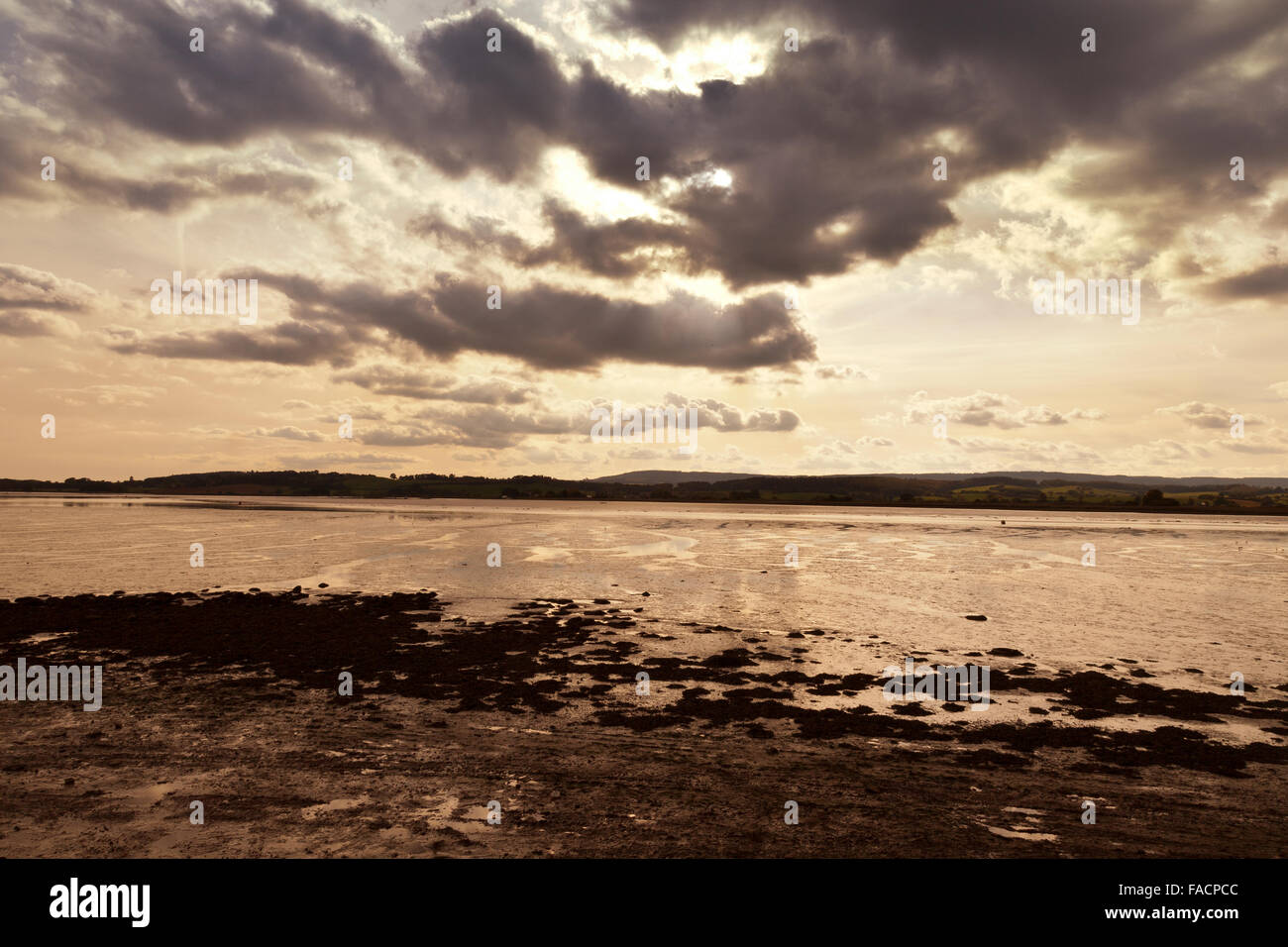 The sun sets over the River Exe estuary at Topsham, Devon, England, UK - Stock Image